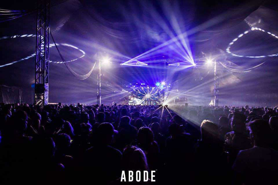 Blue lights on stage at Abode in the Park Festival