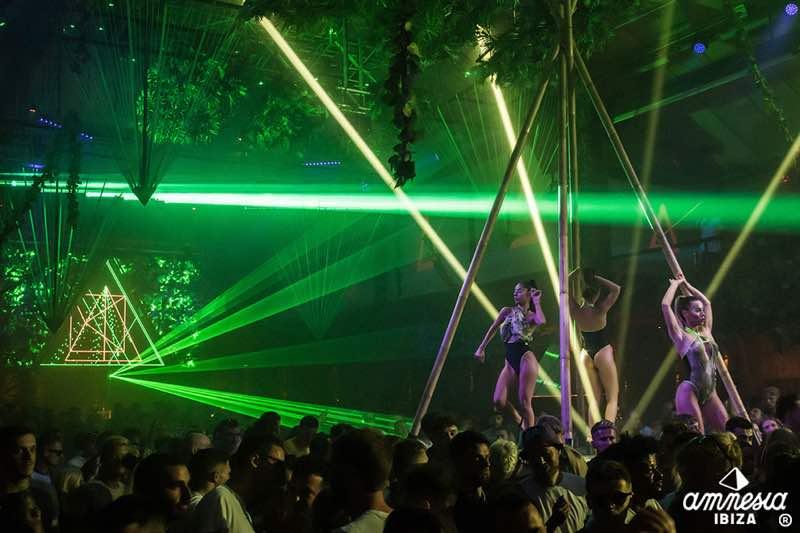 Laser show dancers in Amnesia Ibiza