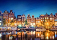 Buildings Lights and canal boat houses in Amsterdam