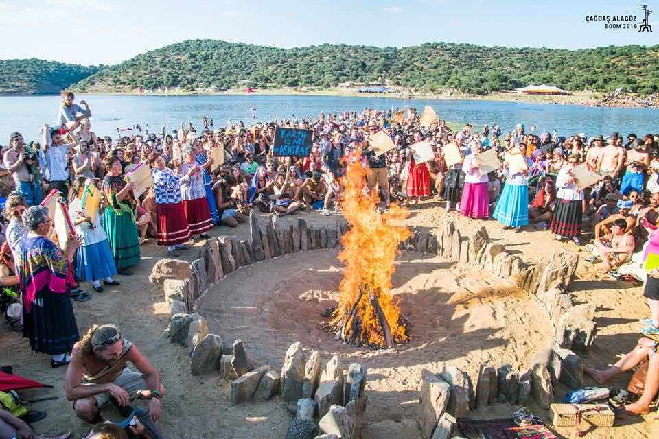 Gathering around the fire at boom festival