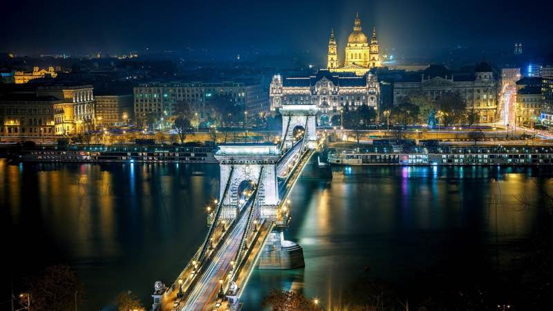 chain bridge evening lights cathedral in Budapest Hungary