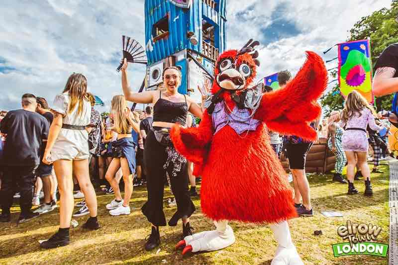 Mascot with fan at Elrow Town London Festival
