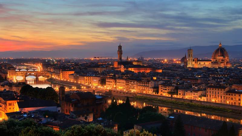 romantic evening river lights in florence italy