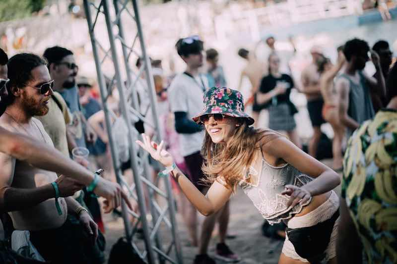 Fans dancing at Hospitality on the Beach Festival