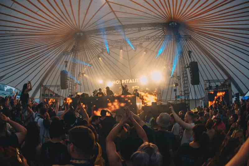 Fans dancing at Hospitality Weekend in the Woods Festival