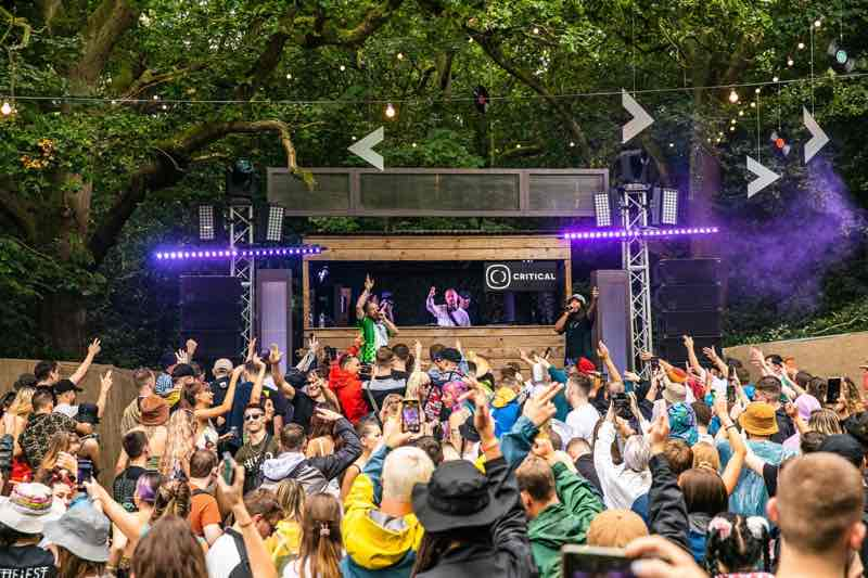 Performing and dancing at Hospitality Weekend in the Woods Festival