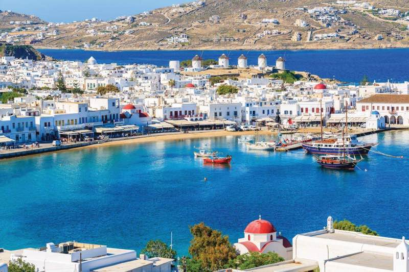 Windmills restaurants boats in Mykonos travel guide