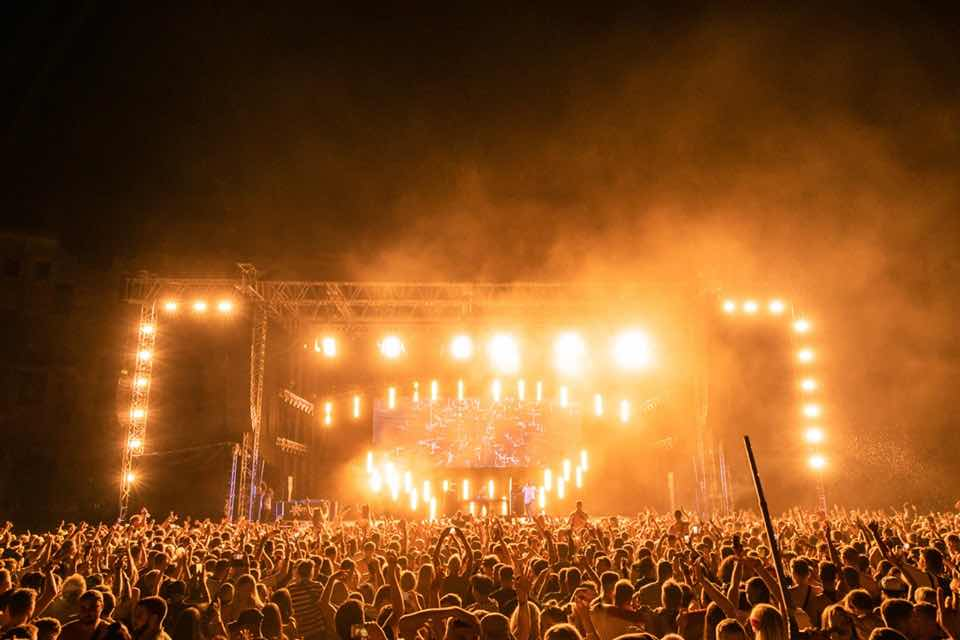 Stage lights and dancing at Outlook Festival