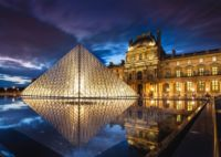 Louvre Museum Pyramid night lights in Paris
