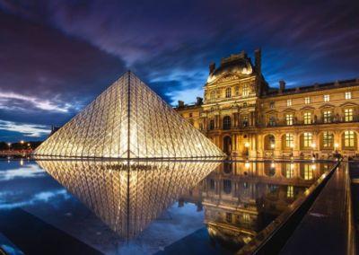 Louvre Museum Pyramid night lights in Paris