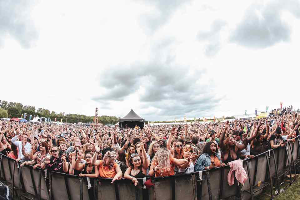 Front row fans dancing at Strawberries and Creem Festival