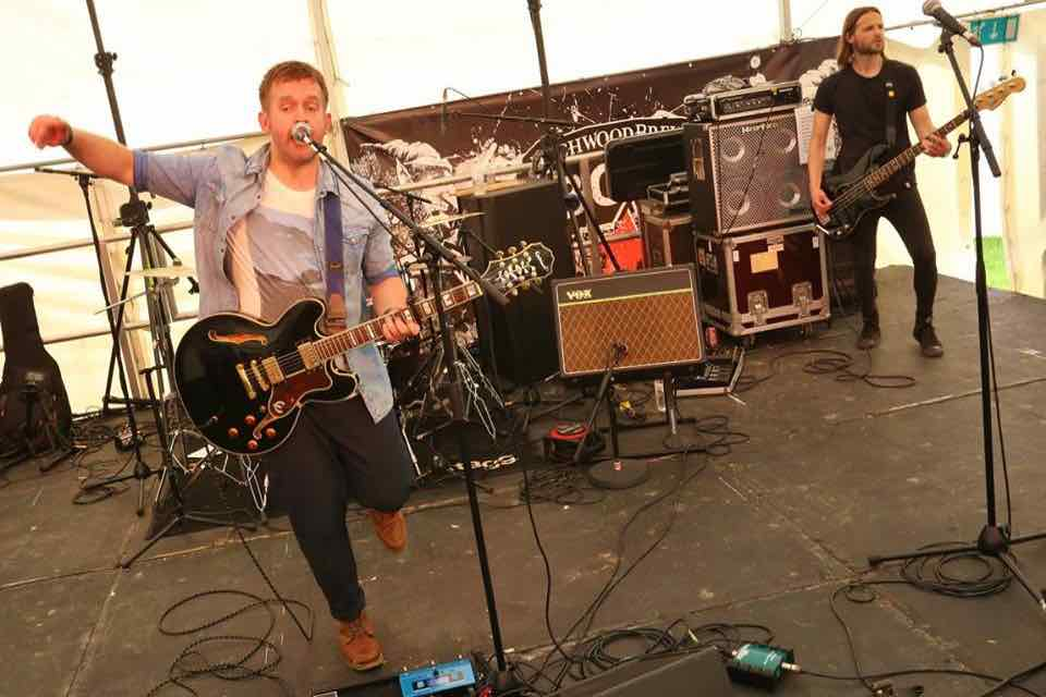 Performing on stage at Wychwood Festival
