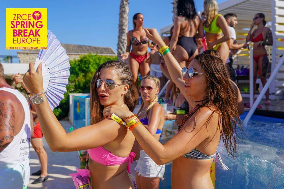 Girls dancing by the pool at zrce spring break europe festival